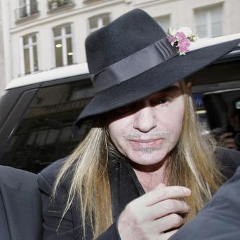 Fashion designer John Galliano arrives at a police station in Paris amid accusations of anti-Semitic behaviour (AP)