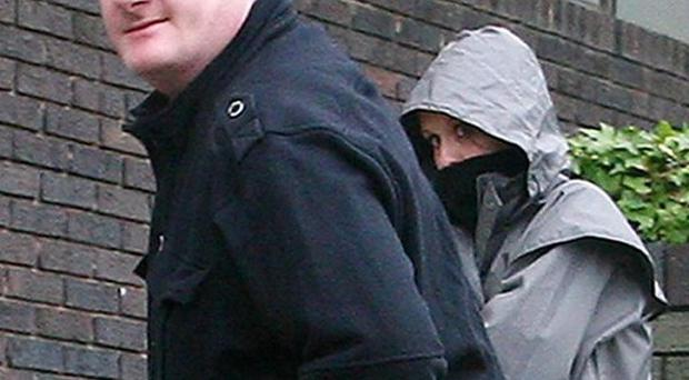 Caroline Bull arrives with an unknown man at Hove Crown Court in West Sussex
