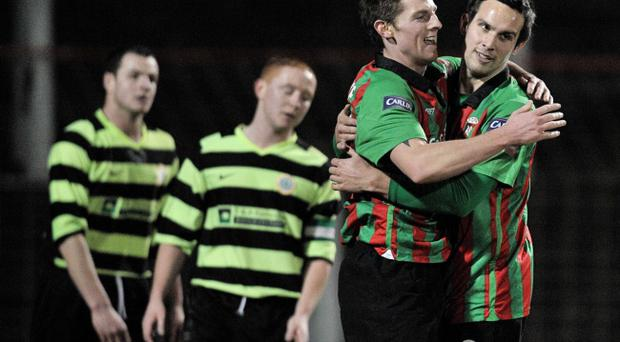 Glentoran's Daryl Fordyce, left, congratulates Andy Waterworth last night