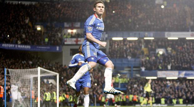Chelsea's Frank Lampard celebrates after scoring his team's second goal during the Barclays Premier League match at Stamford Bridge, London