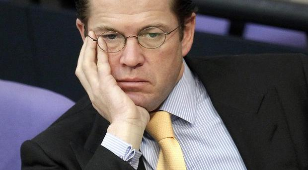 German defence minister Karl-Theodor zu Guttenberg has resigned amid claims he plagiarised his doctoral thesis (AP)