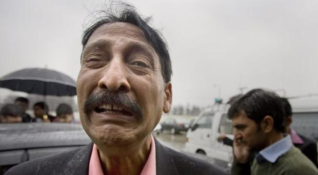 A supporter of Pakistan's government minister for religious minorities Shahbaz Bhatti mourns over his death outside a local hospital in Islamabad, Pakistan on Wednesday, March 2, 2011.