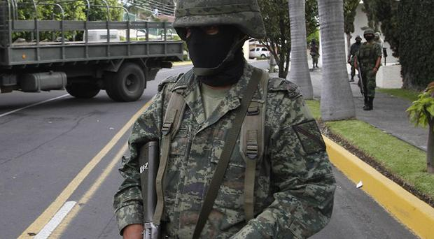 Soldiers unearthed at least 17 bodies buried in several clandestine graves in Guerrero state, Mexico (AP)