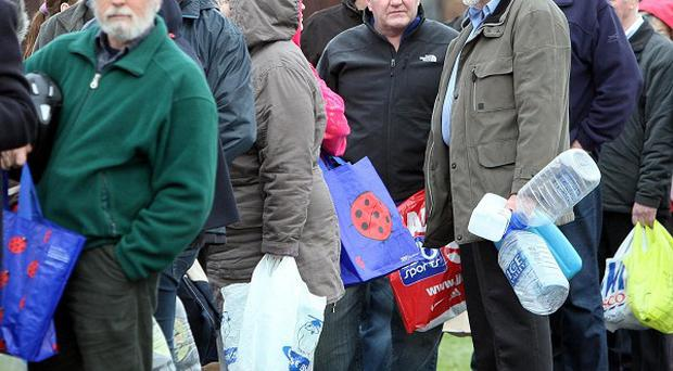 People were forced to queue for drinking water after tens of thousands of homes suffered burst pipes in the cold snap