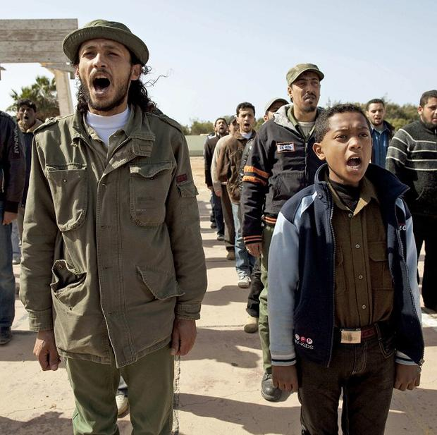 New Libyan rebel recruits chant slogans during a training session in Benghazi, eastern Libya (AP)