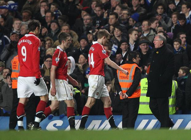 Manchester United's (from left) Dimitar Berbatov, Michael Carrick, Darren Fletcher and manager Alex Ferguson after the final whistle during the Barclays Premier League match at Stamford Bridge, London