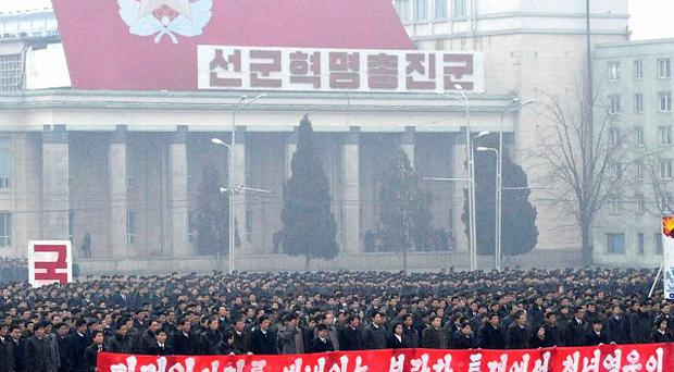 North Koreans march in Kim Il Sung Square in Pyongyang, North Korea
