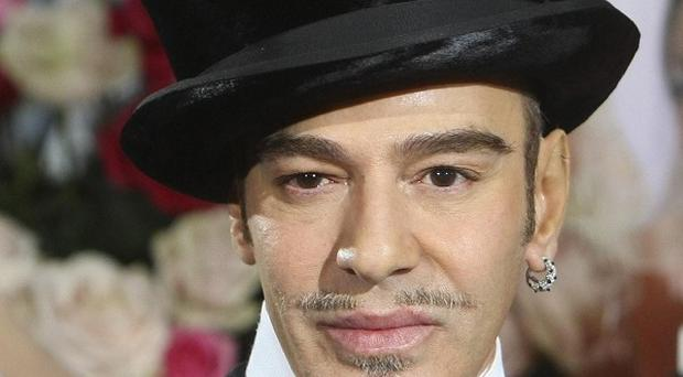 Christian Dior will show its new collection as planned in Paris this week, despite sacking creative director John Galliano (AP)