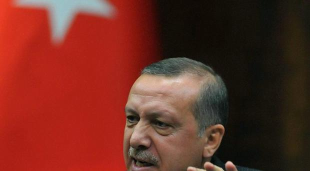 Turkish leader Recep Tayyip Erdogan has accepted undisclosed libel damages (AP)