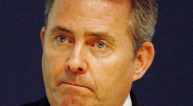 Defence Secretary Liam Fox has been forced to defend a decision over redundancies in the armed forces