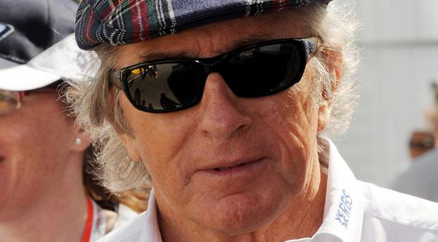Former F1 world champion Sir Jackie Stewart was taken to hospital after falling ill on a London-bound flight