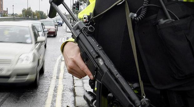 Police fired a shot during an attempted robbery in east Belfast, officers have confirmed