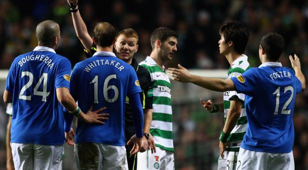 GLASGOW, SCOTLAND - MARCH 02: Referee Calum Murray sends off Steven Whittaker #16 of Rangers during the Scottish Cup fifth round match between Celtic and Rangers at Celtic Park on March 2, 2011 in Glasgow, Scotland. (Photo by Jeff J Mitchell/Getty Images)