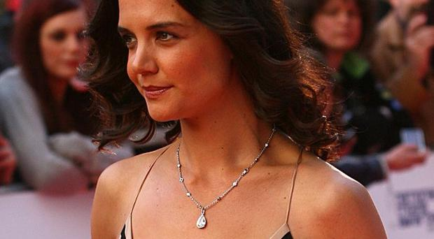 Katie Holmes is suing the publishers of Star Magazine