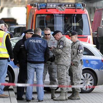 German police and US soldiers investigate after two US airmen were killed at Frankfurt airport, Germany (AP)