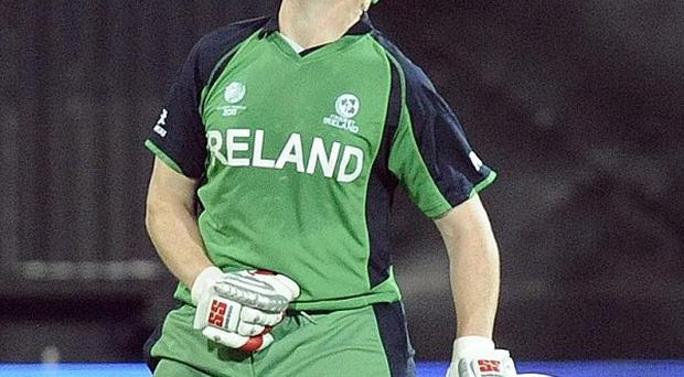 Ireland's Kevin O'Brien celebrates scoring his century during the ICC Cricket World Cup victory over England