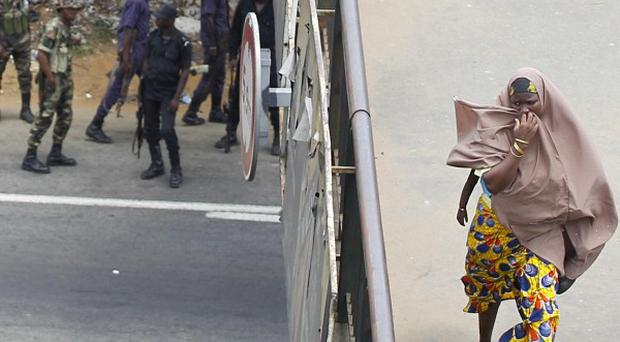 Foot traffic slowly resumes as security forces stand guard on a main road after firing to disperse women protesters (AP)