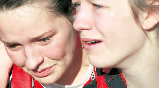 Emotional scenes: Lurgan College captain Natalie Barr (left) with her sister Bethany after their Schools' Cup win