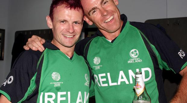 Ireland's William Porterfield and Trent Johnston celebrate in the dressing room after beating England