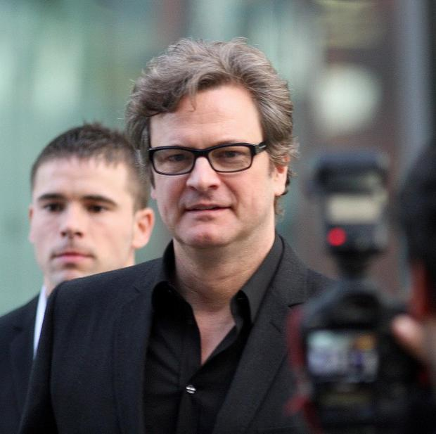 Colin Firth arrives back from Los Angeles following his Oscar triumph on Sunday