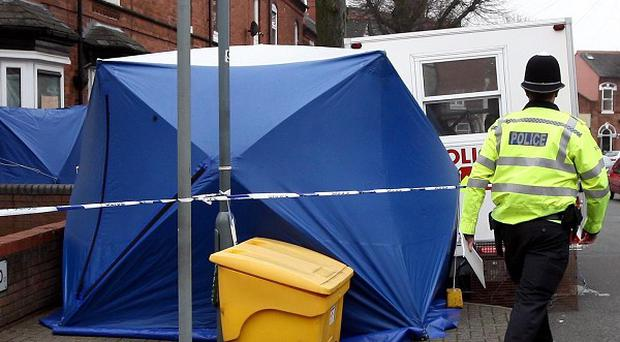 West Midlands Police at a house in Whateley Road, Handsworth, Birmingham, where the body of an 18-year-old woman was found