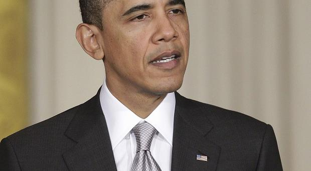 Barack Obama is considering every intervention option in Libya, including military might (AP)
