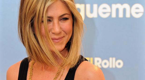Jennifer Aniston's trim was deemed as newsworthy as Libya