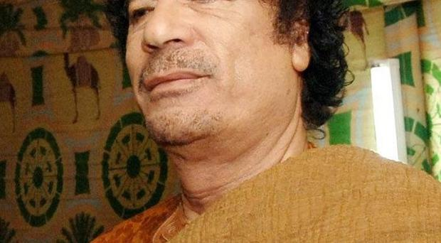 Interpol has issued an international alert for Muammar Gaddafi and 15 other family members