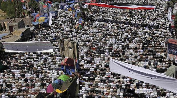 Anti-government protesters attend Friday prayers in Sanaa, Yemen (AP)