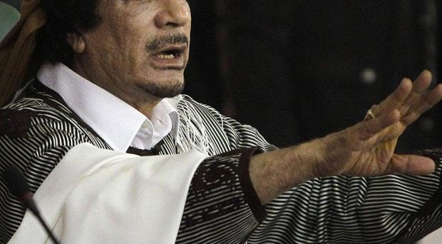 Interpol has issued a worldwide alert against Muammar Gaddafi and 15 of his key supporters (AP)