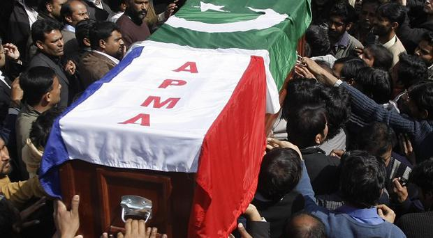 People carry the coffin of Shahbaz Bhatti from a local church after a funeral ceremony in Islamabad, Pakistan (AP)