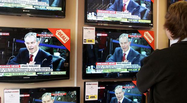 People are buying bigger televisions and watching them more, according to a new survey