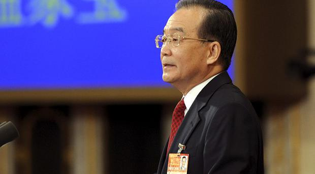 Premier Wen Jiabao vowed more assistance to working class and rural Chinese (AP)