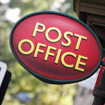 A man has been arrested over an armed robbery of a post office in Dorset