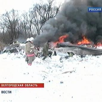In this image taken from TV footage, Russian firemen work at the site of the AN-148 jet crash in Belgorod (AP)