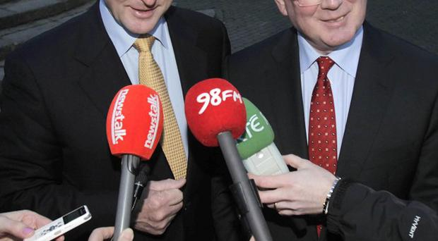 Fine Gael leader Enda Kenny and Labour leader Eamon Gilmore announce they are going to form a coalition government