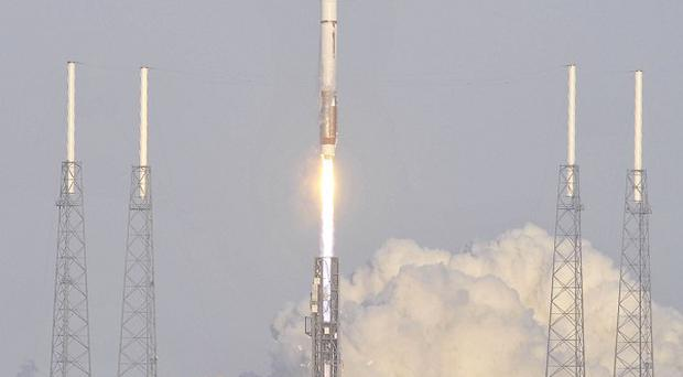 An Atlas 5 rocket blasts off with an unmanned space plane from Cape Canaveral, Florida (A)