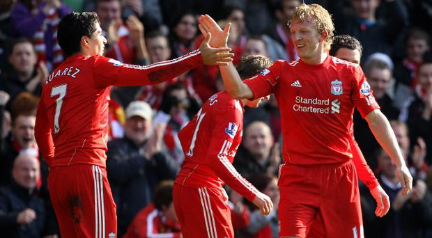 LIVERPOOL, ENGLAND - MARCH 06: Dirk Kuyt of Liverpool celebrates scoring the opening goal with team mate Luis Suarez during the Barclays Premier League match between Liverpool and Manchester United at Anfield on March 6, 2011 in Liverpool, England. (Photo by Alex Livesey/Getty Images)