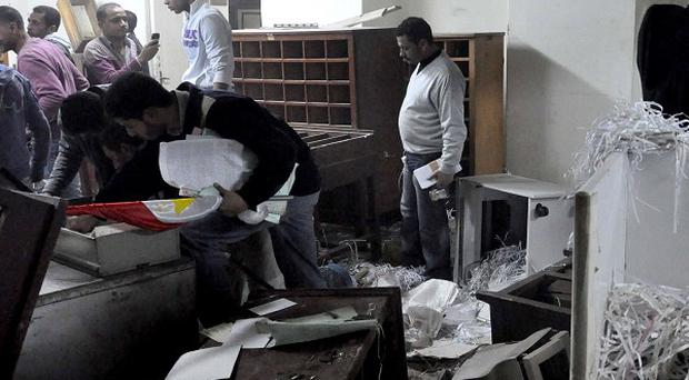 Egyptian protesters have been storming state security agency headquarters (AP)