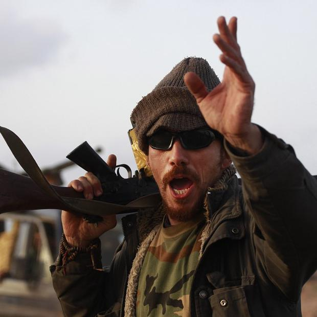 A Libyan rebel near the oil town of Ras Lanuf, eastern Libya (AP)