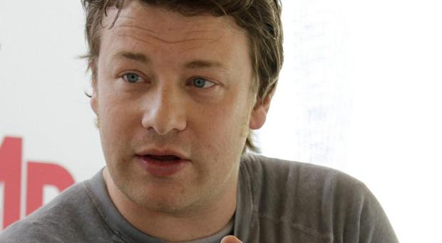 Celebrity chef Jamie Oliver's latest plan to improve school meals in the US is running into difficulties (AP)