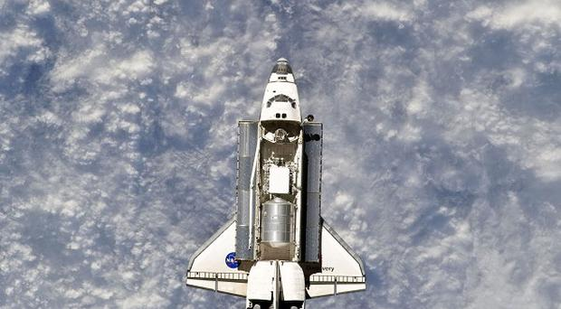 Space shuttle Discovery is about to make its last voyage back to Earth (AP)