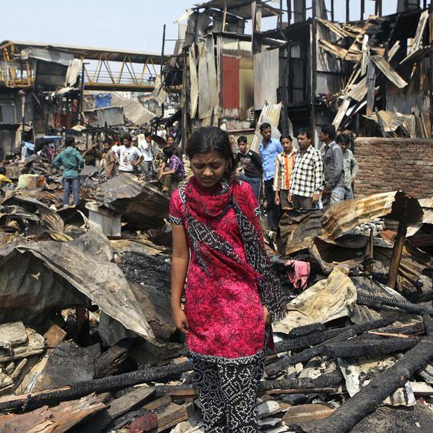 Slumdog Millionaire child star Rubina Ali's home burned down after a fire ripped through a Mumbai slum (AP)