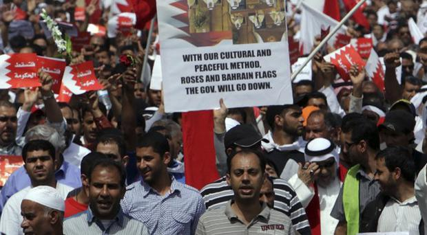 Bahraini anti-government protesters chant slogans outside Gudaibiya Palace in Manama (AP)