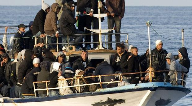 A boat loaded with migrants is spotted at sea off the Sicilian island of Lampedusa, Italy (AP)