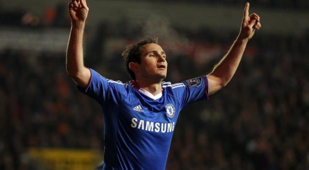 BLACKPOOL, ENGLAND - MARCH 07: Frank Lampard of Chelsea celebrates scoring his team's second goal during the Barclays Premier League match between Blackpool and Chelsea at Bloomfield Road on March 7, 2011 in Blackpool, England. (Photo by Alex Livesey/Getty Images)