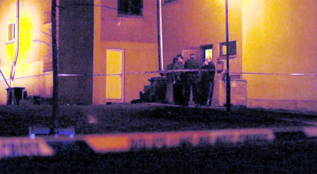 Police seal off an area around houses in Craigavon