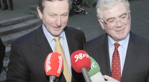 Fine Gael's Enda Kenny (left) and Labour leader Eamon Gilmore