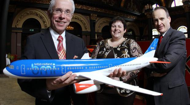 Wolfgang Prock-Schauer (left), chief executive of British Midland International (bmi), with Howard Hastings, chairman of Northern Ireland Tourist Board, and Joanne Stuart, chairman of the Institute of Directors.