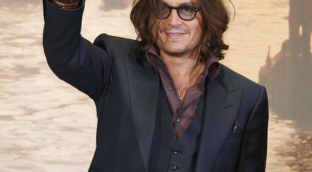 Johnny Depp's animated film Rango topped the US box office after the weekend